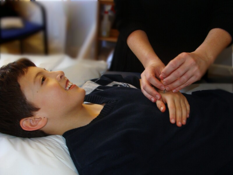 Young receiving acupuncture treatment